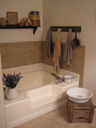Primitive bathroom decor 14 photo bathroom designs ideas for Country bathroom ideas