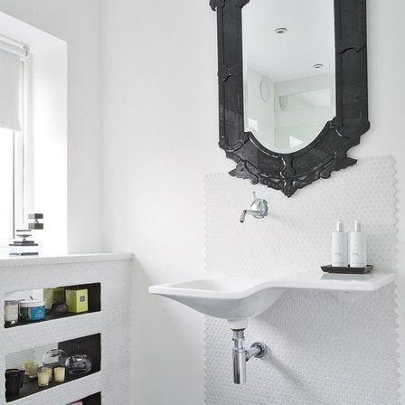 black mirrored bathroom cabinet installation