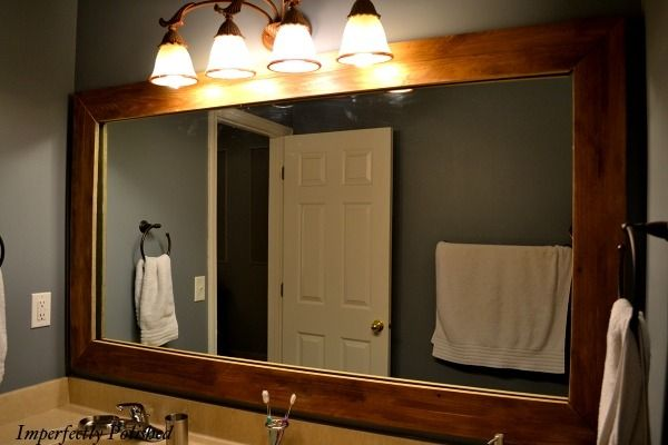 Rustic bathroom mirrors bathroom designs ideas for How to frame mirror in bathroom